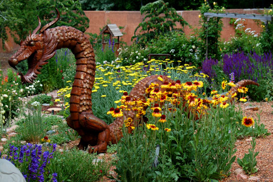 There be dragons among the gaillardia, yarrow, rosemary, and apples in this Santa Fe, NM garden.